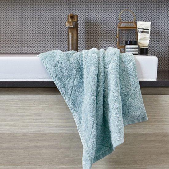 Blauwe handdoeken voor de badkamer - Badkamer blauw ...